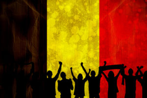 Silhouettes of football supporters against belgium flag in grunge effect